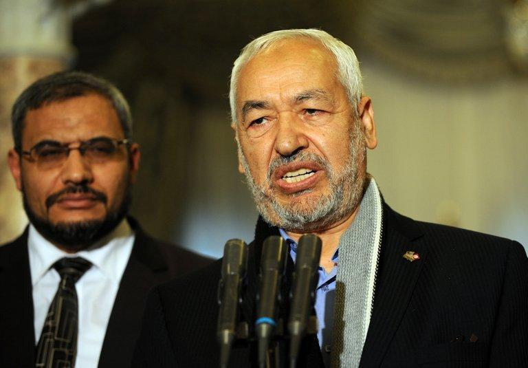 """Islamist ruling Ennahda party leader Rached Ghannouchi speaks to the press following his meeting with Tunisian President Moncef Marzouki on February 20, 2013, at the Carthage palace in Tunis. Ghannouchi said """"numerous parties have expressed their desire to be part of"""" a new government"""