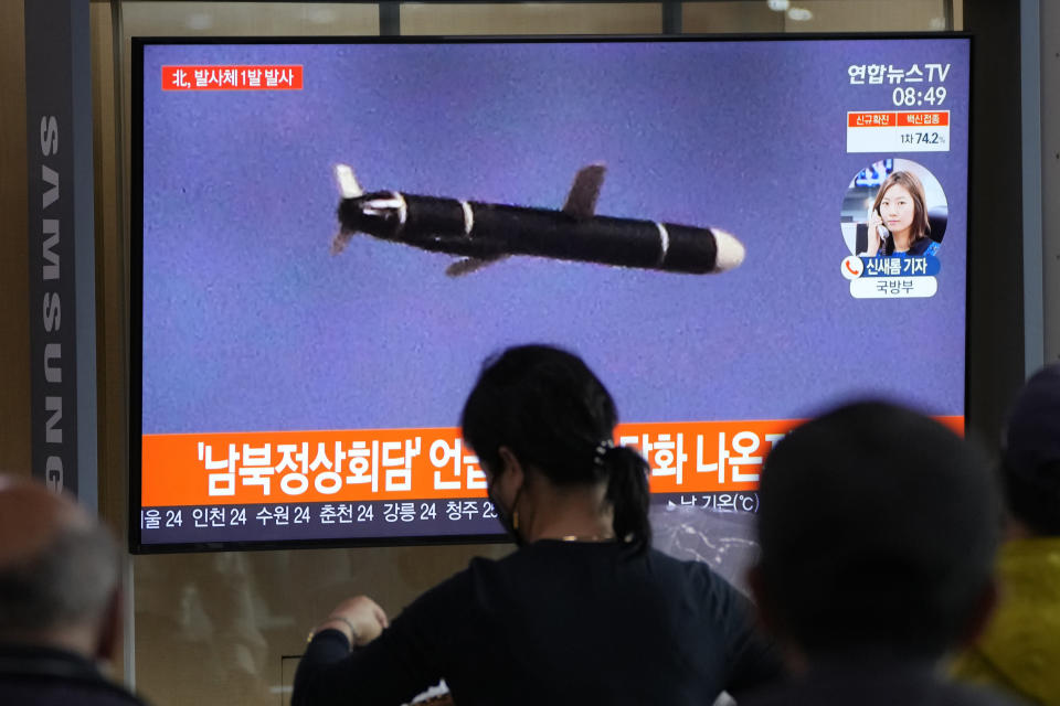 """People watch a TV showing a file image of North Korea's missile launch during a news program at the Seoul Railway Station in Seoul, South Korea, Tuesday, Sept. 28, 2021. North Korea on Tuesday fired a suspected ballistic missile into the sea, Seoul and Tokyo officials said, the latest in a series of weapons tests by Pyongyang that raised questions about the sincerity of its recent offer for talks with South Korea. The Korean letters read: """"After the announcement of the inter-Korean talks."""" (AP Photo/Ahn Young-joon)"""