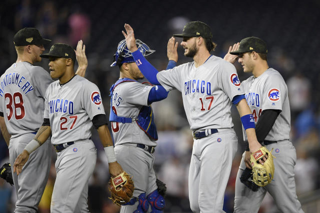 Chicago Cubs' Kris Bryant (17) celebrates with Mike Montgomery (38), Addison Russell (27), Willson Contreras (40) and Anthony Rizzo (44) after a baseball game against the Washington Nationals, Friday, May 17, 2019, in Washington. (AP Photo/Nick Wass)