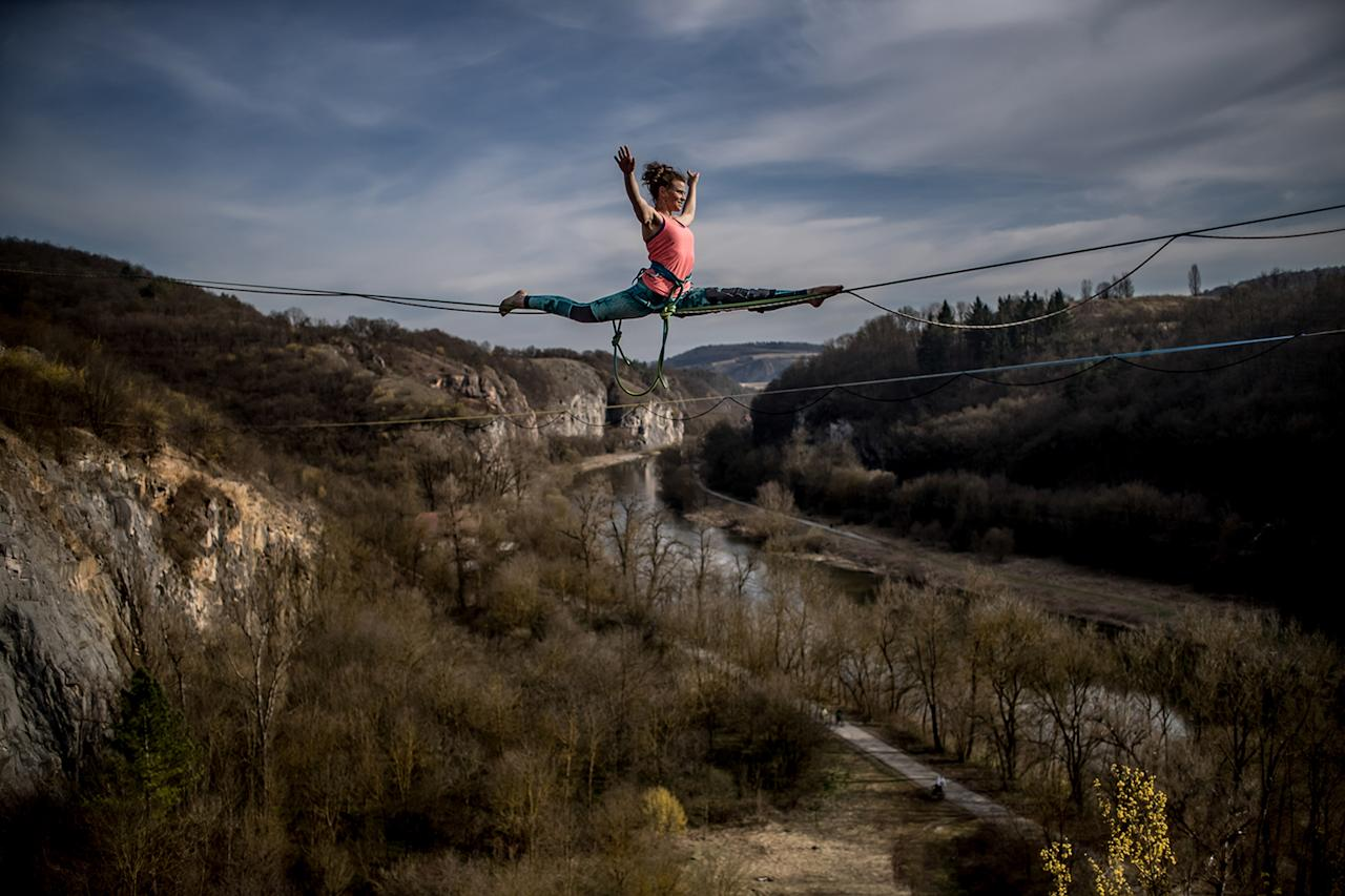<p>A participant balances on a slackline over the former quarry, near village of Srbsko, Czech Republic, March 25, 2017. About 50 participants from Czech Republic, Slovakia and Poland took part in spring highline season opening. Highlining is a style of slacklining, where the two anchor points are set up with significant elevation from the ground or water, between two crags or trees for example. (Photo: Martin Divisek/EPA) </p>