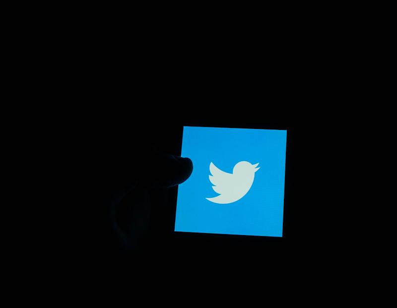 In this photo illustration the Twitter logo is seen displayed on smartphone screen (Photo by Giannis Alexopoulos/NurPhoto via Getty Images)