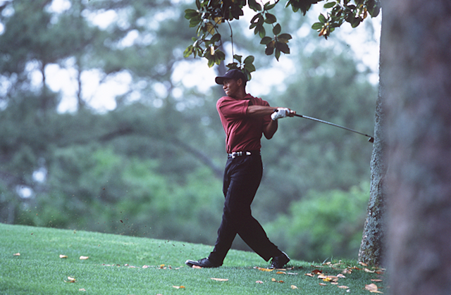 "<div class=""caption""> Tiger hitting a shot on No. 5 in 2002. Photograph by Darren Carroll </div>"