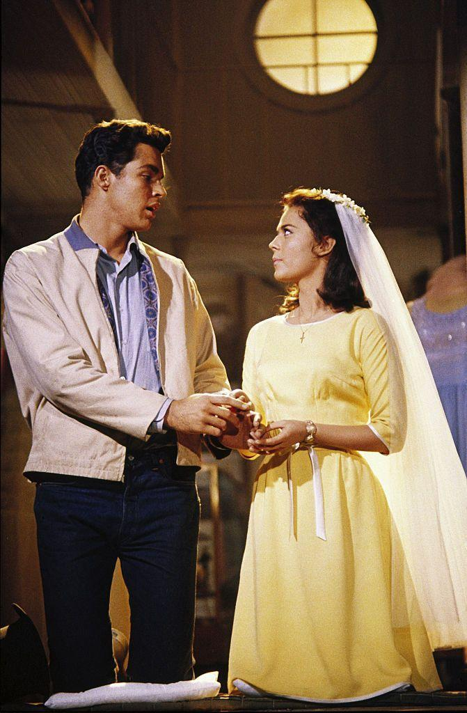 <p>The simple yellow shift dress Natalie Wood wore as Maria in <em>West Side Story</em> is proof that an ensemble doesn't have to be elaborate to be memorable. The wardrobe piece has since become synonymous with the marriage of Maria and Tony. </p>