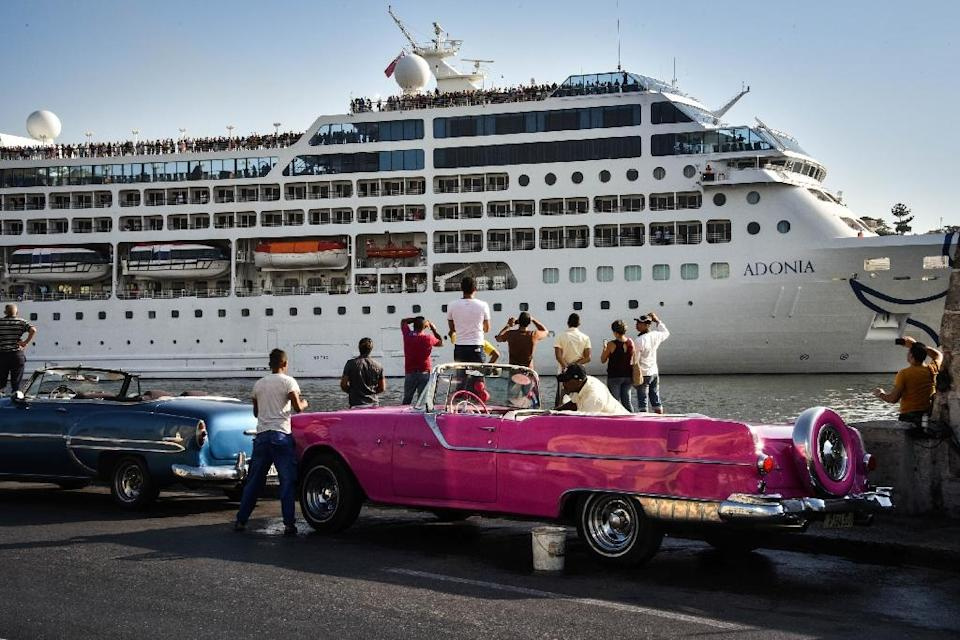 Cubans watch as the first US-to-Cuba cruise ship to arrive in the island nation in decades glides into the port of Havana, on May 2, 2016 (AFP Photo/ADALBERTO ROQUE)