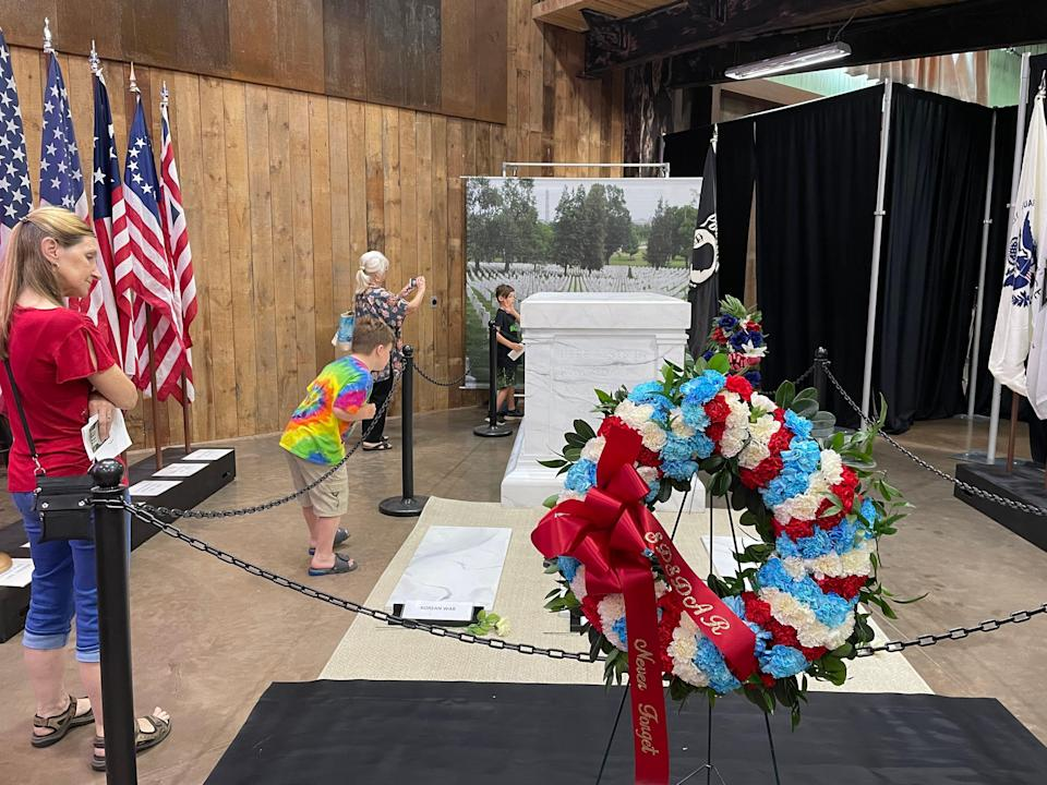 People look at the half-scale replica of the Tomb of the Unknown Soldier at the South Dakota Military Heritage Alliance in Sioux Falls on Saturday.