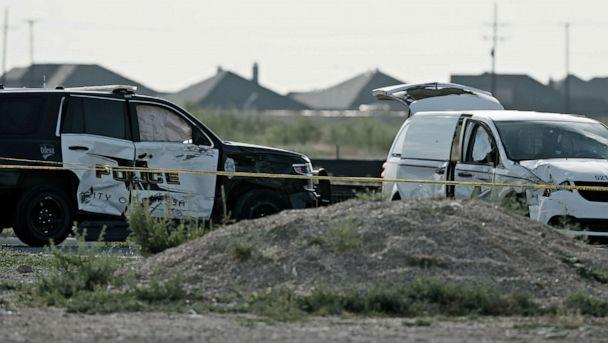 PHOTO: A city of Odessa police car, left, and a U.S. mail vehicle, right, which were involved in Saturday's shooting, are pictured outside the Cinergy entertainment center, Sept. 1, 2019, in Odessa, Texas. (Sue Ogrocki/AP)