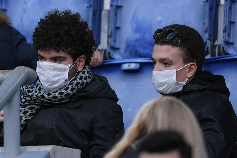 Roma supporters wear masks to protect from the coronavirus while watching a Serie A match against Lecce on Sunday. (Photo by Giuseppe Maffia/NurPhoto via Getty Images)