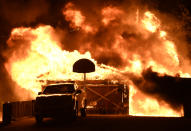 <p>Firefighters battle the fire after it exploded to 31000 acres (Photo: Yahoo Photo Staff) </p>