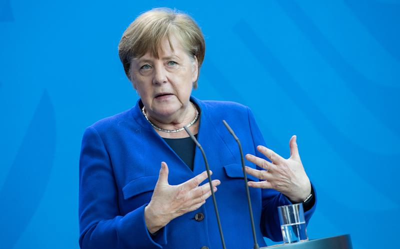 BERLIN, GERMANY - APRIL 20: German Chancellor Angela Merkel speaks to the media following a meeting of the government crisis cabinet on April 20, 2020 in Berlin, Germany. Germany is taking its first steps this week to ease restrictions on public life that had been imposed weeks ago in order to stem the spread of the coronavirus. Shops across the country are reopening, factory assembly lines are restarting and high schools are holding final exams. Health leaders are monitoring the process carefully for any resurgence of coronavirus infections. The number of infections nationwide is still rising, though so far at a declining rate. (Photo by Andreas Gora - Pool/Getty Images)