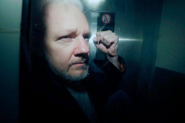 PHOTO: In this May 1, 2019, file photo, WikiLeaks founder Julian Assange puts his fist up as he is taken from court in London. (Matt Dunham/AP, FILE)