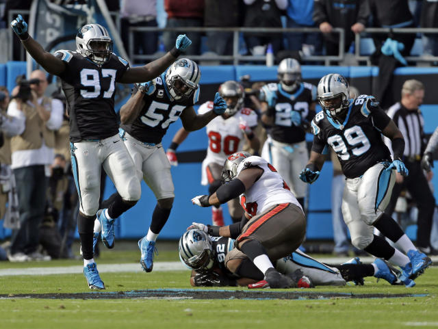 Carolina Panthers' Mario Addison (97) celebrates as Dwan Edwards (92) recovers a Tampa Bay Buccaneers fumble in the first half of an NFL football game in Charlotte, N.C., Sunday, Dec. 1, 2013. (AP Photo/Bob Leverone)