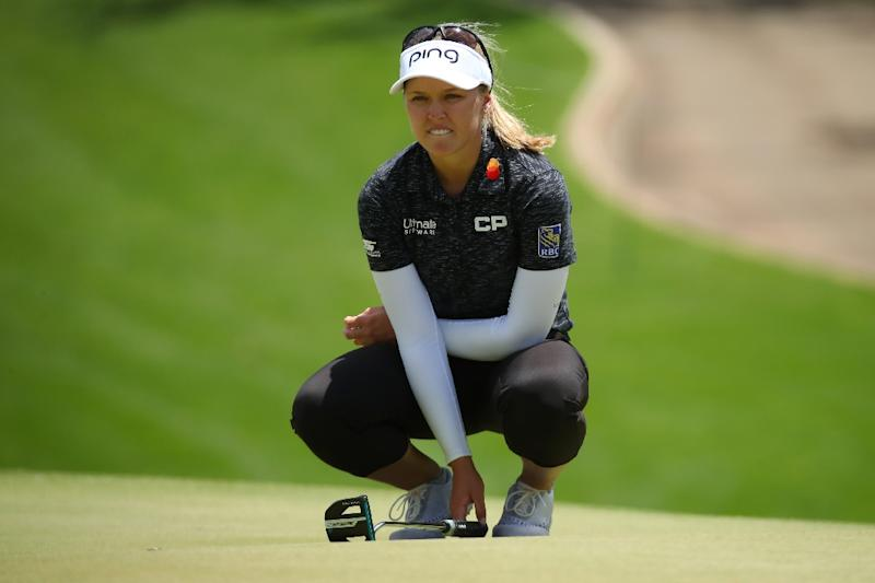 Brooke Henderson reads a putt on the fourth green during the third round of the Lotte Championship in Kapolei, Hawaii