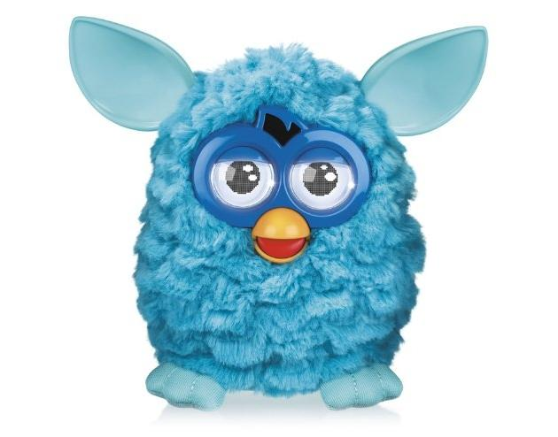 """<b>Furby</b> <br><br> The reappearance of this classic 90s toy might have you checking your calendar. But no, it's not 1999, and yes, this slightly creepy electronic pet is indeed poised for a comeback. This year it's sporting LCD eyes, more realistic facial features, and an accompanying iPhone app. Still just as creepy, though. <br><br> <a href=""""http://www.amazon.com/Hasbro-A0003-Furby-Purple/dp/B008C0O55Q"""">Buy at Amazon</a>"""