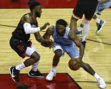 Memphis Grizzlies forward Justise Winslow (7) dribbles as Houston Rockets guard David Nwaba (2) defends during the fourth quarter of an NBA basketball game Sunday, Feb. 28, 2021, in Houston. (Troy Taormina/Pool Photo via AP)
