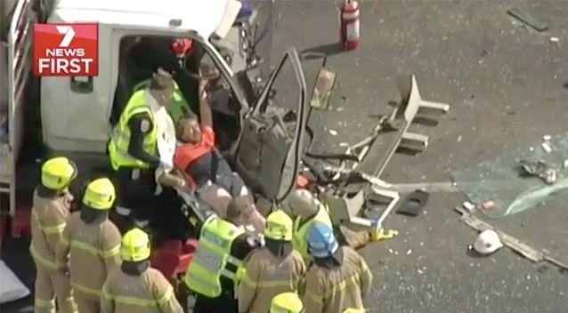 Despite being taken to hospital, the truckie trapped in his vehicle managed to avoid serious injury. Source: 7 News