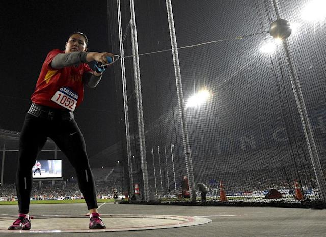 China's Zhang Wenxiu competes in the final of the women's hammer throw athletics event during the 17th Asian Games at the Incheon Asiad Main Stadium in Incheon on September 28, 2014. AFP PHOTO / MARTIN BUREAU (AFP Photo/Martin Bureau)