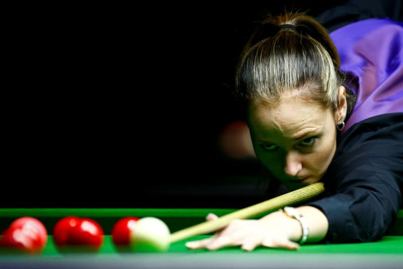 FILE PHOTO: Reanne Evans of England plays a shot during her semi-final match against Ng On-Yee of Hong Kong during the Eden World Women's Snooker Championship in Singapore