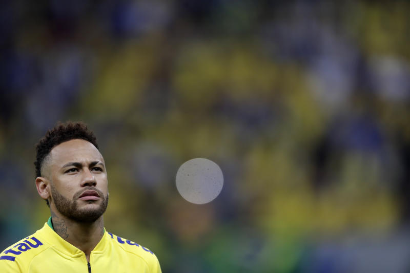 Brazil's Neymar stands on he pitch prior a friendly soccer match against Qatar at the Estadio Nacional in Brasilia, Brazil, Wednesday, June 5, 2019.(AP Photo/Andre Penner)
