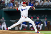 Texas Rangers starting pitcher Kyle Gibson throws during the first inning of a baseball game against the Oakland Athletics, Monday, June 21, 2021, in Arlington, Texas. (AP Photo/Sam Hodde)