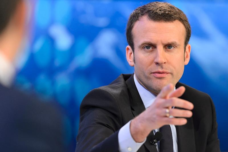 "French Economy Minister Emmanuel Macron said the goverment backed energy giant EDF's plan to build a nuclear plant in the UK: ""The state, as the holder of a comfortable majority of the shares, fully supports the management team."" (AFP Photo/Fabrice Coffrini)"