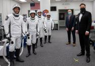 FILE PHOTO: SpaceX CEO and founder Elon Musk visits with astronauts before their launch to the International Space Station