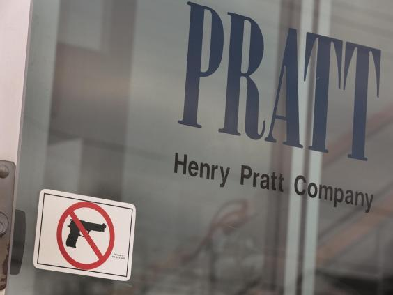 A sign on the front door of the Henry Pratt Company office shows that guns are not allowed in the building (Getty Images)