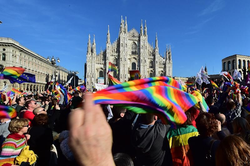 "Supporters of the bill ""Cirinna"" that would allow gay civil unions, currently with the Italian Senate, demonstrate on February 21, 2016 at Piazza Duomo in Milan (AFP Photo/Giuseppe Cacace)"