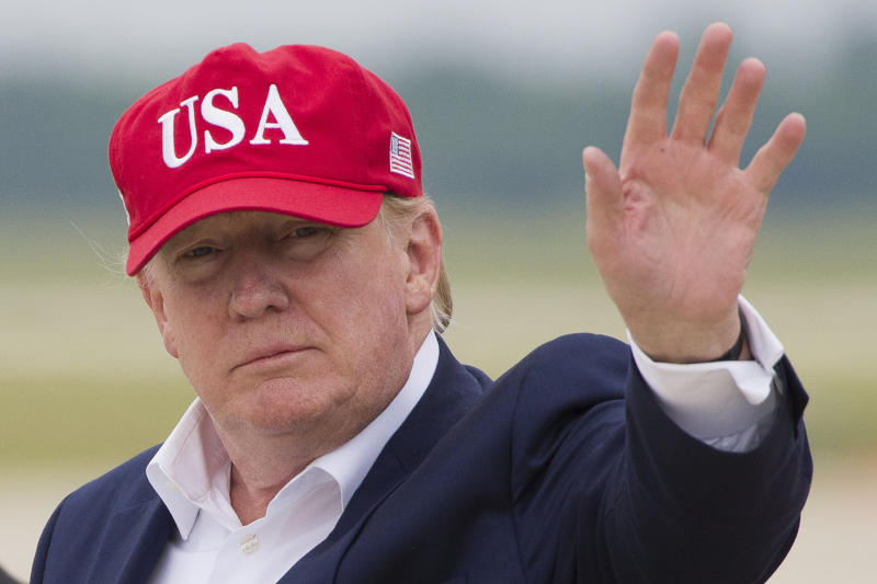 President Donald Trump waves as he steps off Air Force One after arriving, Friday, June 7, 2019, at Andrews Air Force Base, Md. (AP Photo/Alex Brandon)