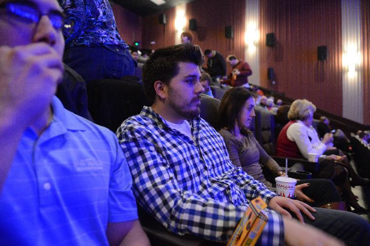 Guests wait in their seats for the reopening and remembrance ceremony at the Century Aurora cinema, formerly the Century 16, Thursday, Jan. 17, 2013 in Aurora, Colo. The cinema is where 12 people were killed and dozens injured in a shooting rampage last July. (AP Photo/The Denver Post, RJ Sangosti, Pool)