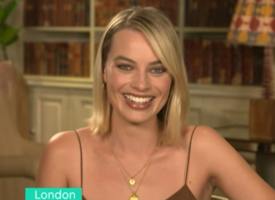 In a recent appearance on UK chat show <em>This Morning</em>, Margot Robbie admitted she had a dialect coach during her <em>Neighbours</em> days to tone down her Aussie accent. Source: ITV