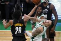 Brooklyn Nets' Spencer Dinwiddie (26) shoots against Boston Celtics' Daniel Theis during the first half of an NBA basketball game, Friday, Dec. 25, 2020, in Boston. (AP Photo/Michael Dwyer)
