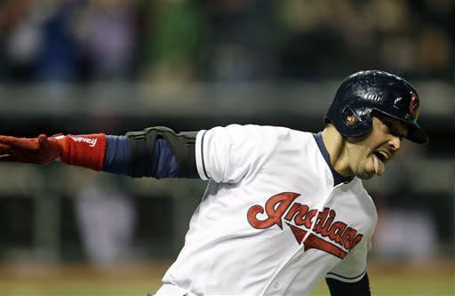 Cleveland Indians' Nick Swisher reacts as he runs the bases after hitting a game-winning RBI-single off Chicago White Sox's Jesse Crain during the ninth inning of a baseball game, Friday, April 12, 2013, in Cleveland. Cleveland won 1-0. (AP Photo/Tony Dejak)