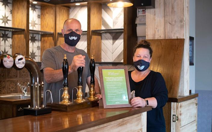 Emma Shepherd and her husband- prepare to re open the Blue Ball Inn, Sheffield for the first time since lock down in March - Bethany Clarke
