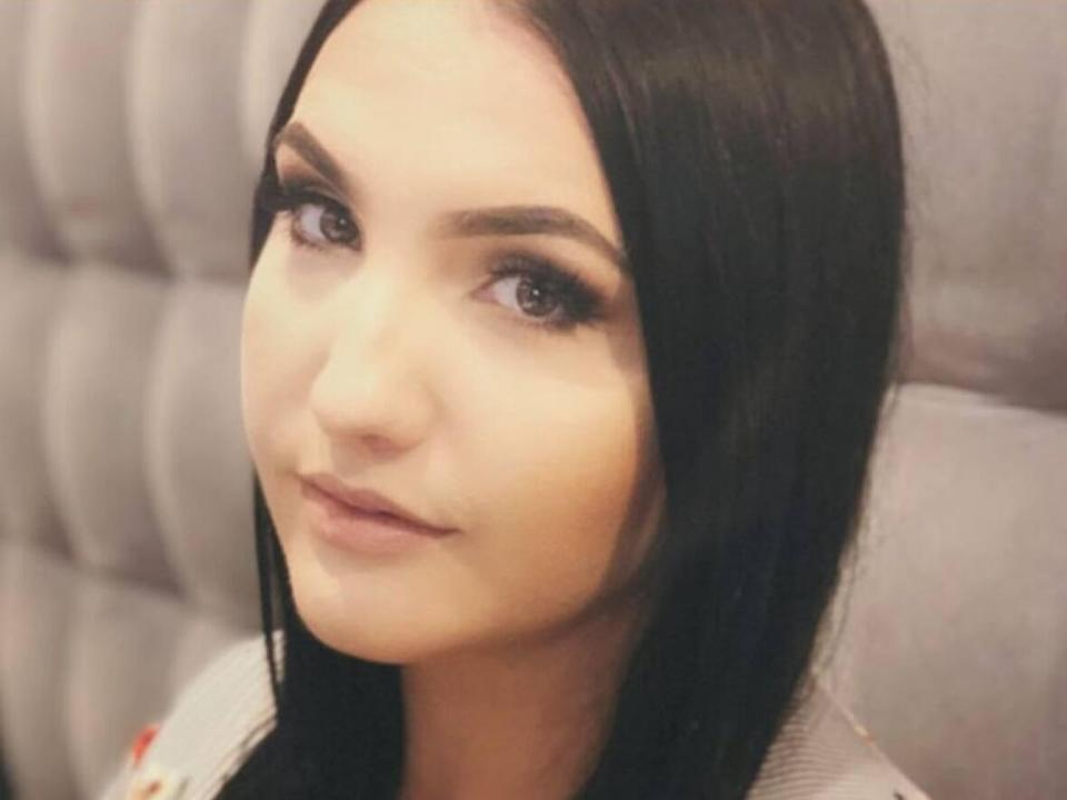 Julia Ferguson, 29, died in hospital after she was stabbed at a downtown Toronto law firm where she worked.  (Supplied - image credit)