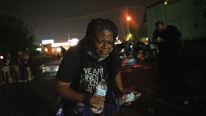 Cori Bush uses water to rinse her face after being tear-gassed by police in Florissant, Missouri, on July 5. She went back to campaigning for Congress the following morning. (Lawrence Bryant/Reuters)