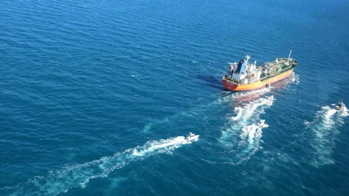 "In this photo released Monday, Jan. 4, 2021, by Tasnim News Agency, the MT Hankuk Chemi, a South Korean-flagged tanker is escorted by Iranian Revolutionary Guard boats on the Persian Gulf. Iranian state television acknowledged that Tehran seized the oil tanker in the Strait of Hormuz. The report on Monday alleged the MT Hankuk Chemi had been stopped by Iranian authorities over alleged ""oil pollution"" in the Persian Gulf and the strait. (Tasnim News Agency via AP)"