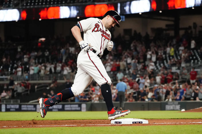 Atlanta Braves' Adam Duvall (14) rounds third base after hitting a two-run home run in the eighth inning of a baseball game against the Colorado Rockies Tuesday, Sept. 14, 2021, in Atlanta. (AP Photo/John Bazemore)