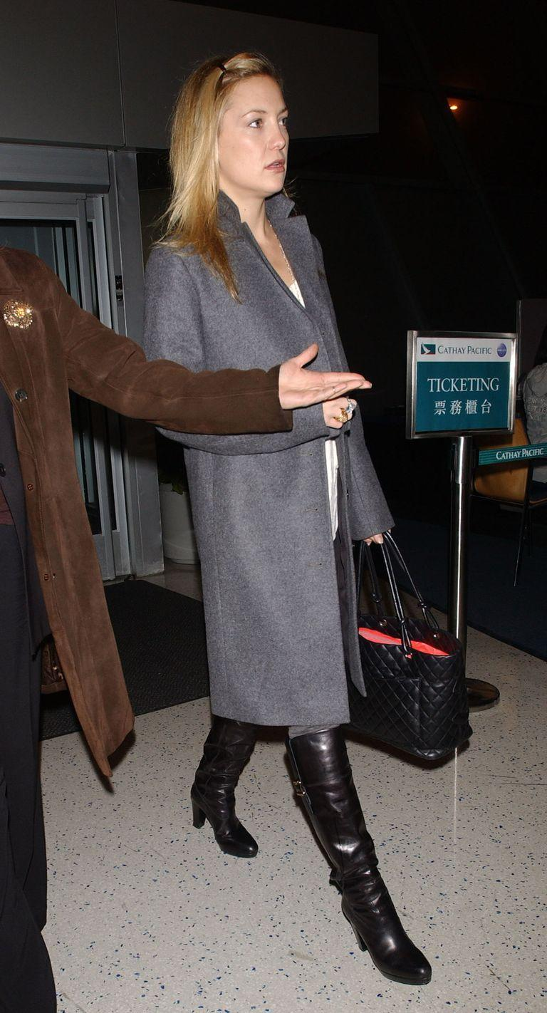 <p>Kate Hudson is prepared for New York City's winter chill as she departs from JFK in a grey overcoat in November 2007. </p>