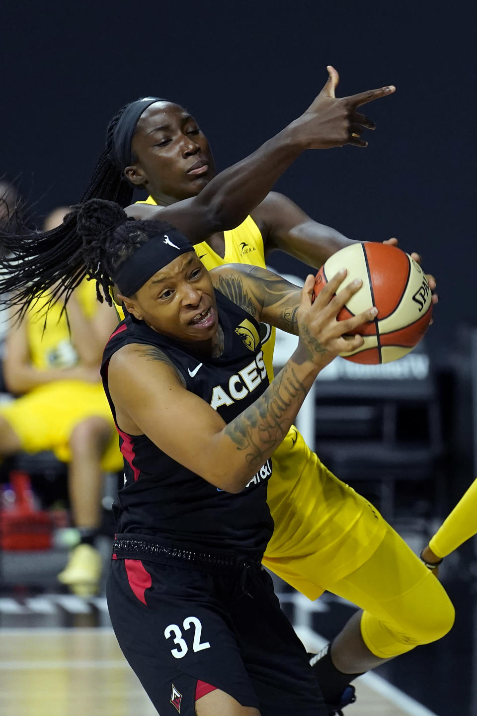 Las Vegas Aces forward Emma Cannon (32) grabs a rebound away from Seattle Storm center Ezi Magbegor (13) during the first half of Game 1 of basketball's WNBA Finals Friday, Oct. 2, 2020, in Bradenton, Fla. (AP Photo/Chris O'Meara)