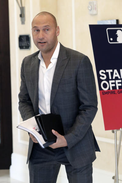 Derek Jeter, CEO and part owner of the Miami Marlins, leaves a meeting during MLB baseball owners meetings, Thursday, Feb. 6, 2020, in Orlando, Fla. (AP Photo/John Raoux)