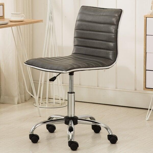 "<h2>Wrought Studio Penkridge Conference Chair</h2> <br><strong>Best For: Budgets</strong><br>This contemporary desk chair is pretty straightforward in terms of streamlined style, but it still packs adjustable capabilities from wheels to a swivel seat and height all for under $100 buckeroos.<br><br><strong>The Hype: </strong>4.7 out of 5 stars and 1,369 reviews on <a href=""https://www.wayfair.com/furniture/pdp/wrought-studio-penkridge-conference-chair-wrse1538.html"" rel=""nofollow noopener"" target=""_blank"" data-ylk=""slk:Wayfair"" class=""link rapid-noclick-resp"">Wayfair</a><br><br><strong>Comfy Butts Say:</strong> ""Comfortable and strong. As a graphic designer, I spend a lot of time at my desk and have dealt with back pain before. This chair has great support while still looking minimalistic. I'd definitely recommend it!""<br><br><strong>Wrought Studio</strong> Penkridge Conference Chair, $, available at <a href=""https://go.skimresources.com/?id=30283X879131&url=https%3A%2F%2Fwww.wayfair.com%2Ffurniture%2Fpdp%2Fwrought-studio-penkridge-conference-chair-wrse1538.html"" rel=""nofollow noopener"" target=""_blank"" data-ylk=""slk:Wayfair"" class=""link rapid-noclick-resp"">Wayfair</a><br><br><br><br><br><br>"