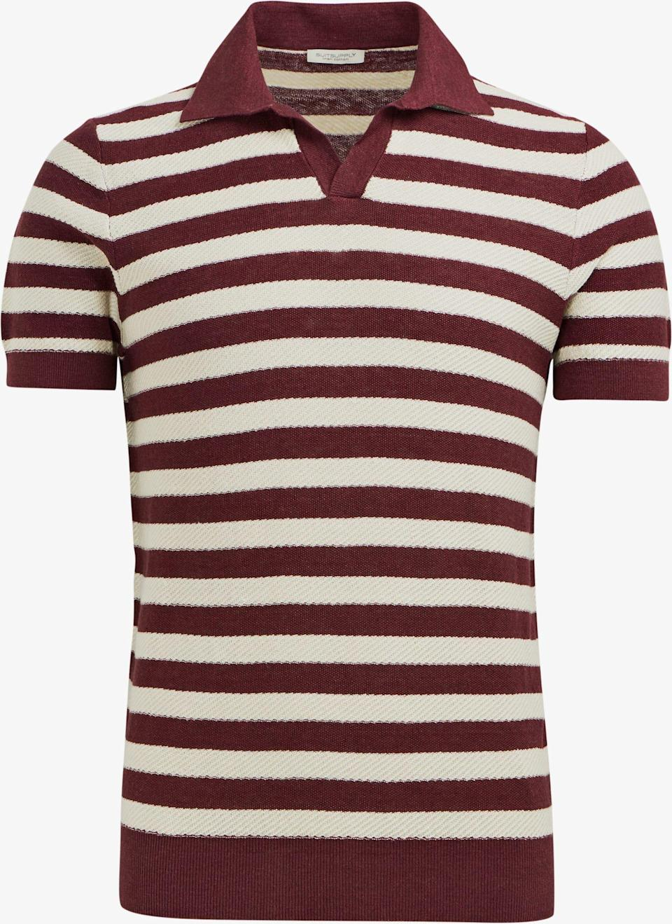 """<p><strong>Suitsupply</strong></p><p>suitsupply.com</p><p><strong>$47.00</strong></p><p><a href=""""https://outlet-us.suitsupply.com/en_US/knitwear/burgundy-stripe-polo/SW1053.html"""" rel=""""nofollow noopener"""" target=""""_blank"""" data-ylk=""""slk:Buy"""" class=""""link rapid-noclick-resp"""">Buy</a></p>"""