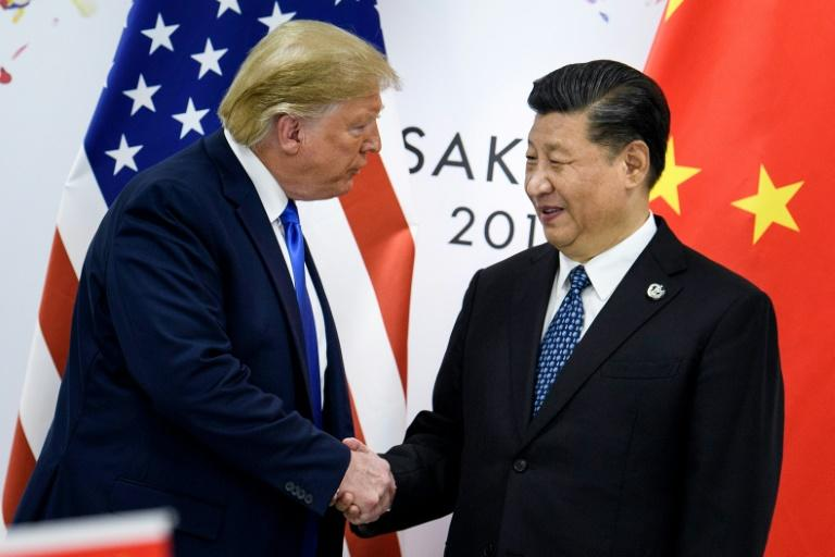US President Donald Trump, pictured in June 2019 with China's President Xi Jinping, announced he will sign a partial US-China trade deal in January 2020