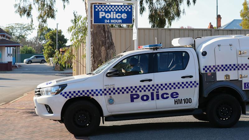 A file photo of a WA Police car leaving a police station in Perth.