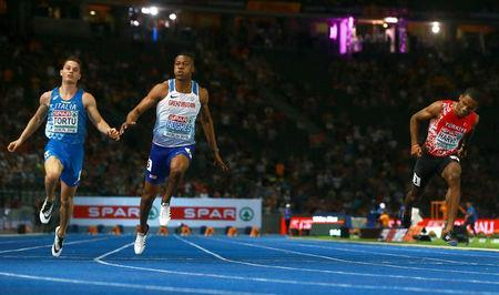 2018 European Championships - Men's 100 meters, Final - Olympic Stadium, Berlin, Germany - August 7, 2018 - Zharnel Hughes of Britain, Filippo Tortu of Italy and Jak Ali Harvey of Turkey in action. REUTERS/Michael Dalder