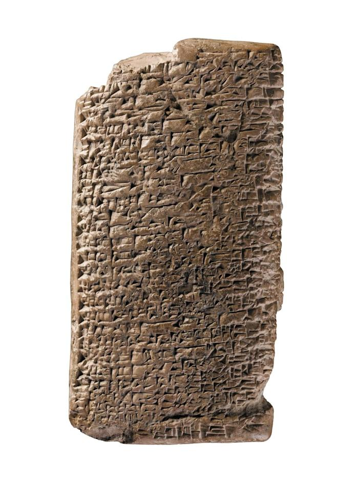 A terra cotta tablet covered in cunieform writing.