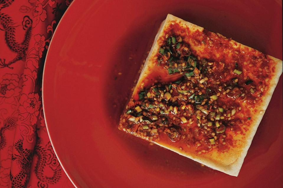 """Soft tofu gets custardy when warmed, so this is almost like a spicy, savory pudding. Add some rice and you basically have the best food ever for watching Netflix. <a href=""""https://www.epicurious.com/recipes/food/views/warm-tofu-with-spicy-garlic-sauce-351871?mbid=synd_yahoo_rss"""" rel=""""nofollow noopener"""" target=""""_blank"""" data-ylk=""""slk:See recipe."""" class=""""link rapid-noclick-resp"""">See recipe.</a>"""