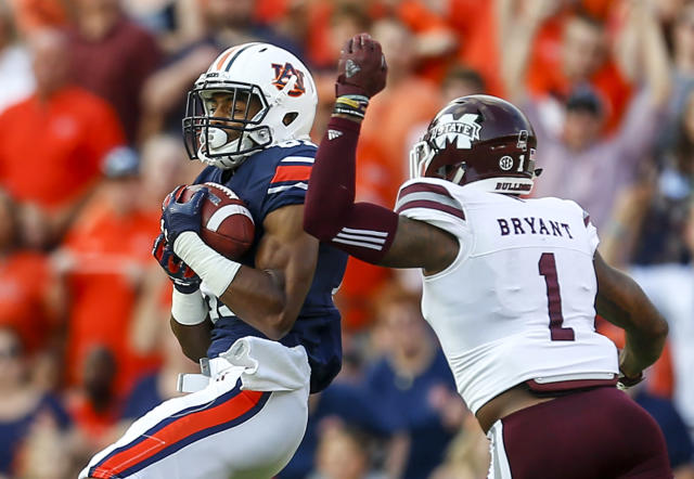 Auburn wide receiver Darius Slayton (81) catches a pass over Mississippi State defensive back Brandon Bryant (1) during the first half of an NCAA college football game, Saturday, Sept. 30, 2017, in Auburn, Ala. (AP Photo/Butch Dill)