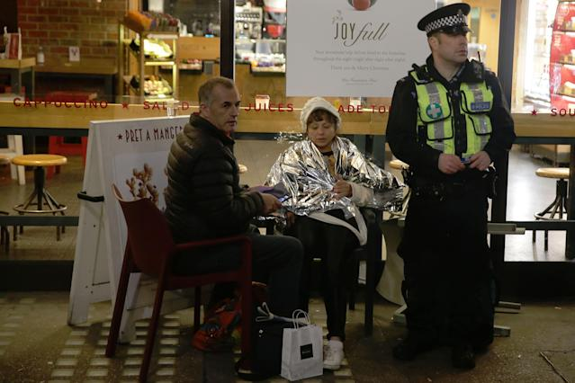 <p>A policeman sits with a couple of shoppers in a coffee shop in Regent Street in central London on Nov. 24, 2017, as police responded to an incident. (Photo: Daniel Leal-Olivas/AFP/Getty Images) </p>