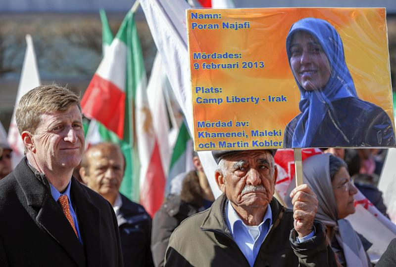 Former U.S. Congressman Patrick J. Kennedy II, left, with unidentified demonstrator during a rally in Stockholm, Sweden, Saurday, April 6, 2013 in support of Iranian opposition group Mujahedin-e Khalq, or MEK. Hundreds of supporters of an Iranian opposition group have rallied in Stockholm, denouncing the Islamic Republic's regime and urging the U.N. to better protect the group's members in neighboring Iraq. Former U.S. Congressman Patrick Kennedy was among the speakers Saturday at the demonstration. (AP Photo/Fredrik Persson) SWEDEN OUT